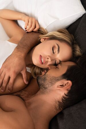 Photo for tender couple hugging with closed eyes in bed in the morning - Royalty Free Image