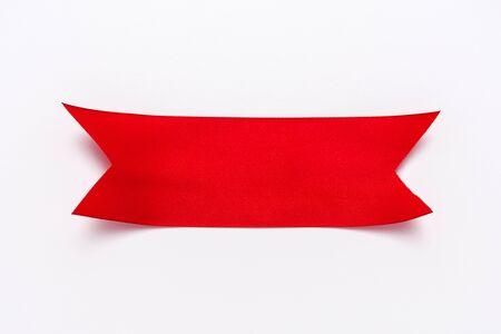 Photo pour top view of red decorative ribbon on white - image libre de droit