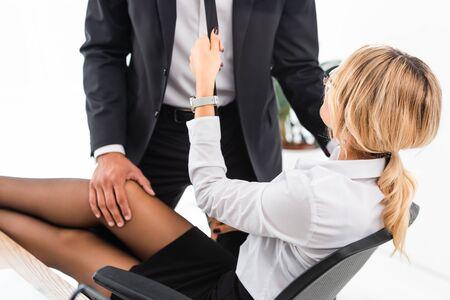 Photo pour Seductive businesswoman flirting with colleague at office table - image libre de droit