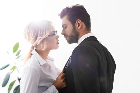 Photo pour Side view of businessman and businesswoman looking at each other while flirting in office - image libre de droit