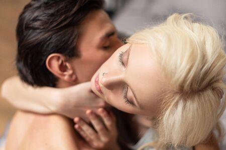 Photo pour Overhead view of attractive blonde woman hugging boyfriend - image libre de droit