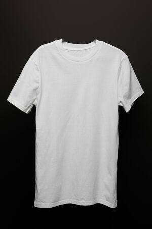 Photo for blank basic white t-shirt isolated on black - Royalty Free Image