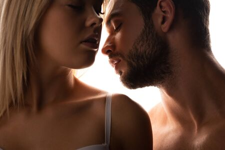 Photo pour close up of attractive woman and sensual man, isolated on white - image libre de droit