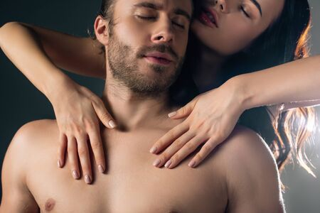 Photo pour passionate young woman hugging man on grey with back light - image libre de droit