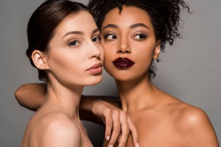Photo pour portrait of naked multicultural girls with perfect skin, on grey - image libre de droit