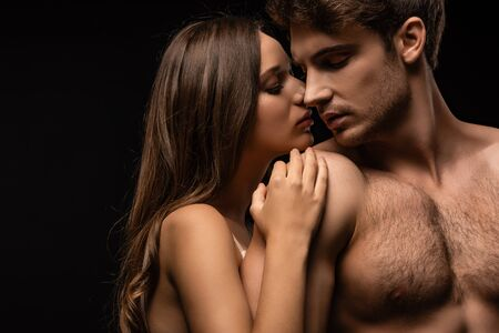 Photo for undressed sexy young couple embracing isolated on black - Royalty Free Image