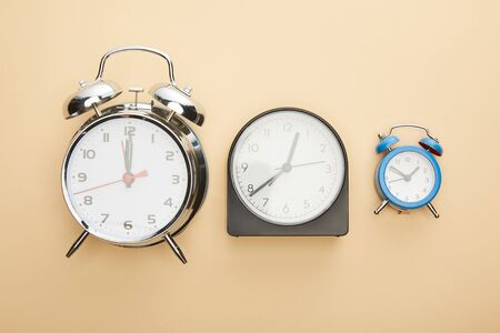 Photo pour top view of clocks on blue background - image libre de droit