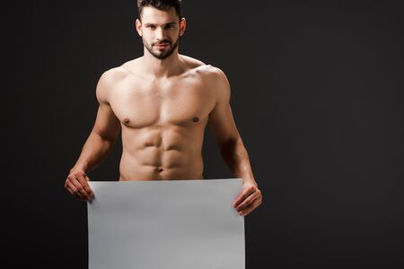 Photo for sexy naked man holding blank placard isolated on black - Royalty Free Image