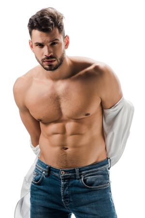 Photo pour seductive muscular man in white shirt and jeans isolated on white - image libre de droit