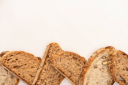 Foto für top view of whole grain bread slices on white background with copy space - Lizenzfreies Bild