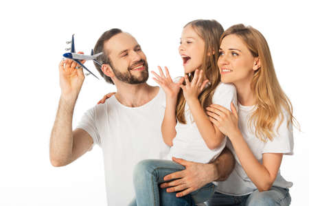 Photo pour happy smiling family with plane model isolated on white - image libre de droit