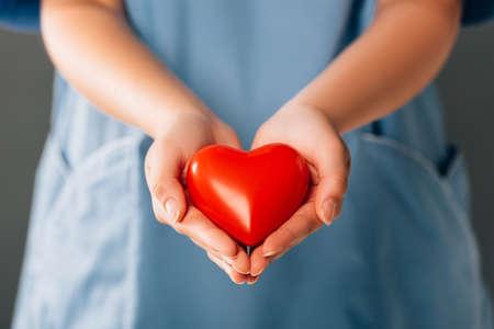 Foto de cropped view of doctor holding red heart - Imagen libre de derechos