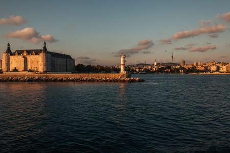 Photo for Lighthouse on coast of sea during sunset, Istanbul, Turkey - Royalty Free Image