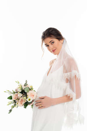 Photo for pregnant fiancee holding wedding bouquet while looking at camera isolated on white - Royalty Free Image