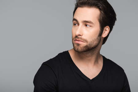 Photo pour bearded and good-looking man in black t-shirt looking away isolated on gray - image libre de droit