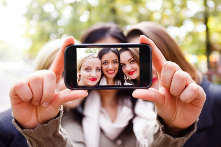Students taking a self portrait with smart phone.