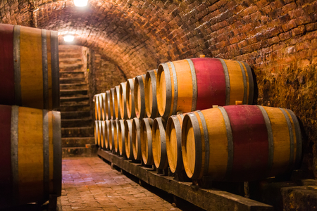 Oak barrels in a traditional hungarian cellar for producing wine.