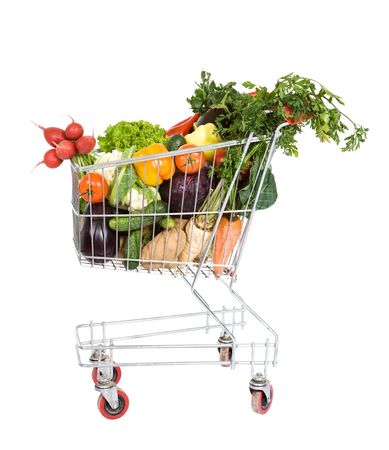 Shopping cart filled with fresh vegetables - isolated