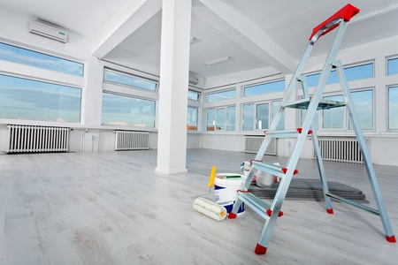 Photo pour Newly renovated generic empty office space with leftover materials and ladder in foreground - image libre de droit