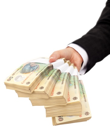 Photo pour Hand holding stacks of romanian currency - isolated - image libre de droit