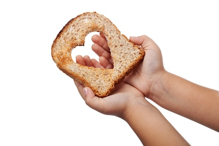 Photo pour Giving food with love concept - slice of bread in child hands, isolated - image libre de droit