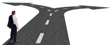 Business crossroads - decisions and strategic planning concept with businessman and forking road