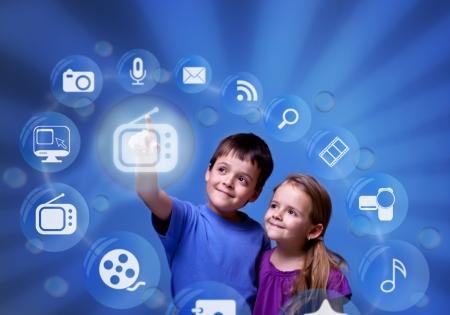 Photo pour Kids accessing futuristic entertainment applications from the cloud computing interface - image libre de droit
