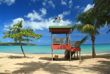 A lifeguard post stands in front of a calm aqua bay at Seven Seas Beach near Fajardo, Puerto Rico