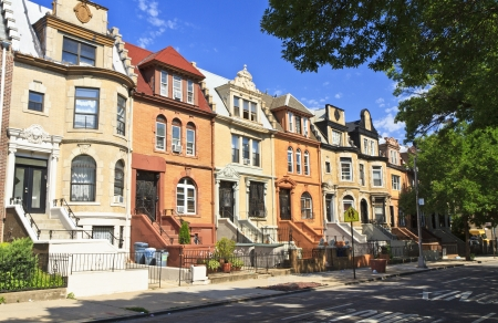 A row of unique townhouse apartment buildings with stoops on New York Ave. in the Crown Heights neighborhood of Brooklyn, NY