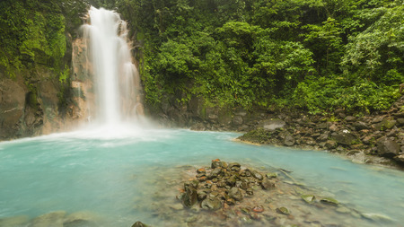 Panoramic image of the cerulean blue waters of the Rio Celste Waterfall in Volcan Tenoria National Park, Costa Rica.
