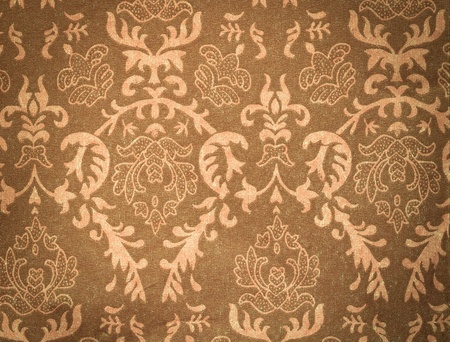 faded brown vintage background with damask-like ornamental pattern