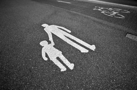 Photo for parental guidance concept - pedestrian sign on the  pavement/sidewalk - Royalty Free Image