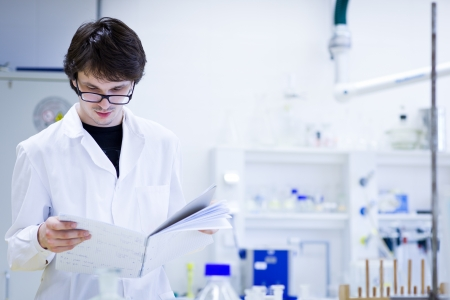 young male researcher carrying out scientific research in a chemistry lab
