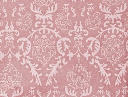 light pink vintage background with damask-like ornamental pattern