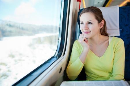Photo pour Young woman traveling by train - image libre de droit