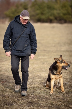 Master and his obedient  German Shepherd  dog