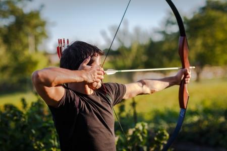 Photo pour Young archer training with the  bow - image libre de droit