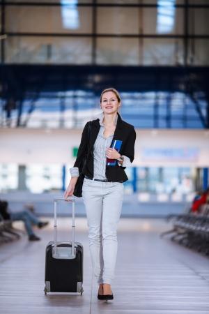 Photo pour Pretty young female passenger at the airport  - image libre de droit