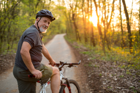 Photo for Senior man on his mountain bike outdoors (shallow DOF; color toned image) - Royalty Free Image