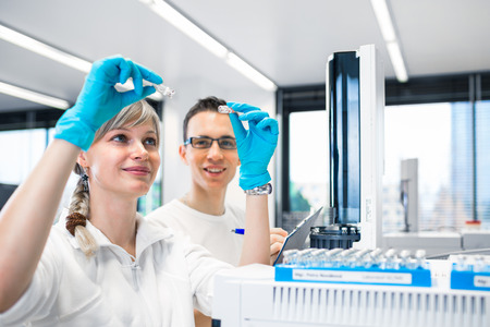Photo for senior male researcher carrying out scientific research in a lab using a gas chromatograph (shallow DOF; color toned image) - Royalty Free Image