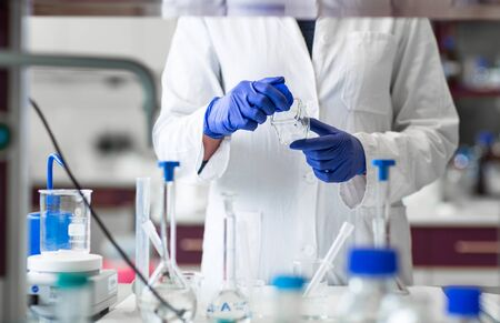 Photo for Researcher carrying out scientific research in a lab (shallow DOF; color toned image) - Royalty Free Image