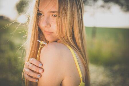 Foto de Portrait of young, pretty  woman outdoor on a summer sunny day - Imagen libre de derechos