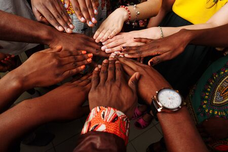 Photo pour Hands of happy group of multinational African, latin american and european people which stay together in circle - image libre de droit
