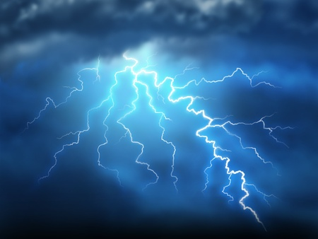 Lightning storm thunderstorm with a bolt of light electricity from a dark cloudy blue night sky showing power of natural destruction and dramatic weather storm resulting in disaster and electrical shock.