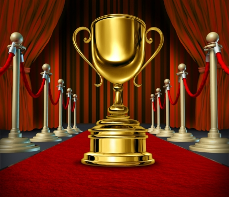 Golden Cup On a red Carpet with velvet Curtains as a reward for a cinema show or theater performance on  a broadway stage or movie screening as a best of show  and VIP treatment or start treatment.
