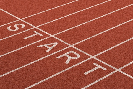Starting line as a business symbol of the metaphore saying ready set go for the start or beginnings of a planned strategy for success as represented by a track and field stadium background as a concept of opportunity and setting goals