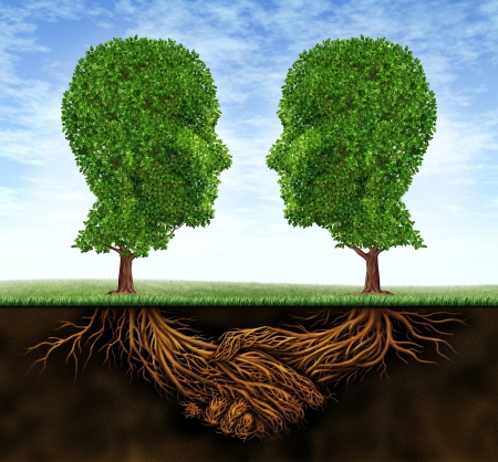 Business collaboration teamwork and growth with roots in the shape of a hand shake and trees as human heads for trust and integrity in a growing financial relationship for strong wealth success