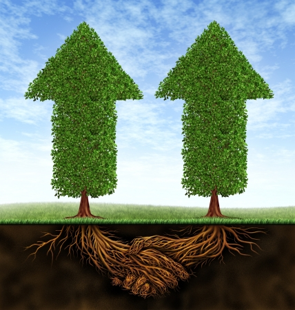 Business partnership growth as an icon of financial cooperation between two partners as trees in the shape of arrows growing and plant roots shaped as shaking hands resulting in success