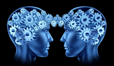 Teamwork and business cooperation with two human heads facing each other with gears and cogs representing their brains as a symbol of industry working together