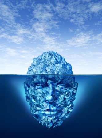 Exploration and discovery concept with an iceberg floating on a blue ocean and the underwater portion of the frozen ice is in the shape of a human head as a business and life symbol in searching for opportunities and dangers